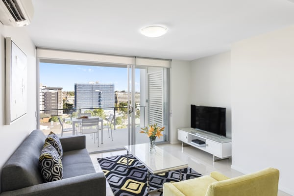 air conditioned 1 bedroom Woolloongabba hotel apartment with television and balcony with views of Brisbane