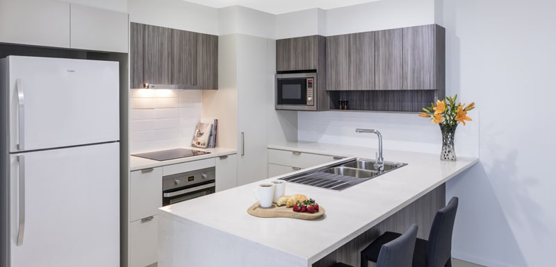 Oaks Woolloongabba hotel 1 bedroom apartment kitchen with microwave and fridge close to The Gabba cricket stadium