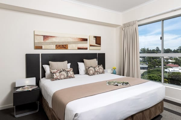 comfortable queen size bed in air conditioned 3 bedroom apartment at Oaks Aspire hotel Ipswich, Queensland