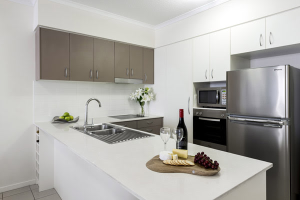 modern kitchen with large refrigerator and microwave at Oaks Aspire hotel Ipswich, Queensland