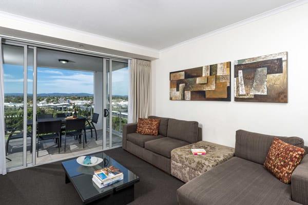 Oaks Aspire hotel 3 bedroom apartment living room area with TV and balcony in Ipswich, Queensland