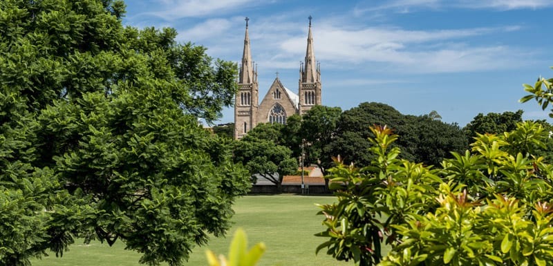 park and cathedral with blue sky in background in Ipswich, Queensland