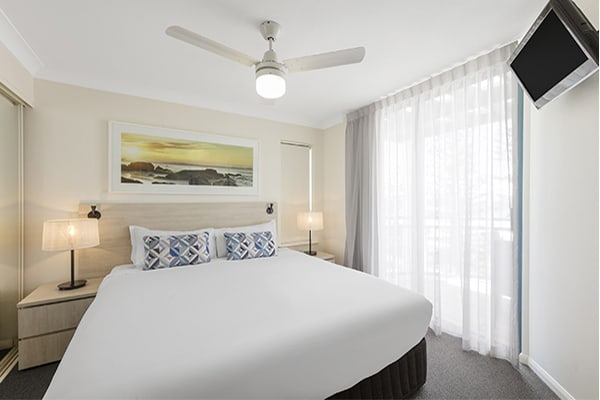 one bedroom ocean premier apartment with fan and TV at Oaks Calypso Plaza resort in Gold Coast, Australia