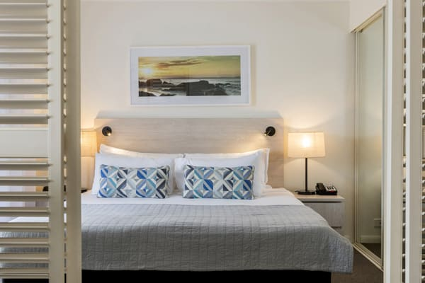 queen size bed in 1 bedroom apartment near Snapper Rocks on Gold Coast at Oaks Calypso Plaza hotel resort