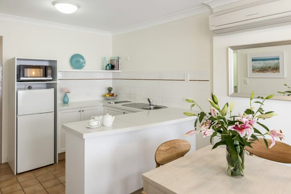 air conditioned 1 bedroom apartment kitchen with big fridge, microwave, toaster and kettle in Coolangatta