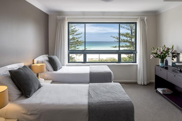 two single beds in 2 bedroom apartment with views of ocean at Oaks Calypso Plaza hotel resort in Coolangatta on Gold Coast, Australia