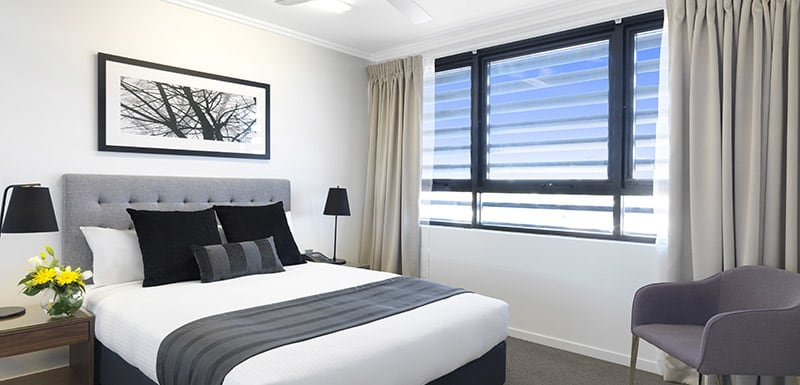 air conditioned three bedroom hotel apartment master bedroom with comfortable queen size bed with clean sheets in Mackay QLD