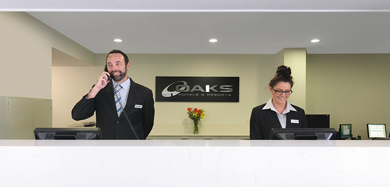 helpful staff at reception area of Oaks Carlyle hotel in Mackay welcoming new guests and travellers