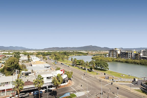 view of Ross Creek and Townsville from balcony of Gateway on Palmer hotel one bedroom apartment