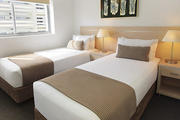 two single beds in second bedroom of 2 bedroom apartment at Oaks Gateway Suites hotel in South Townsville, Australia