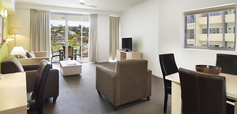big air conditioned living room with desk for corporate travellers to do work while visiting Townsville on business at Gateway on Palmer hotel in South Townsville