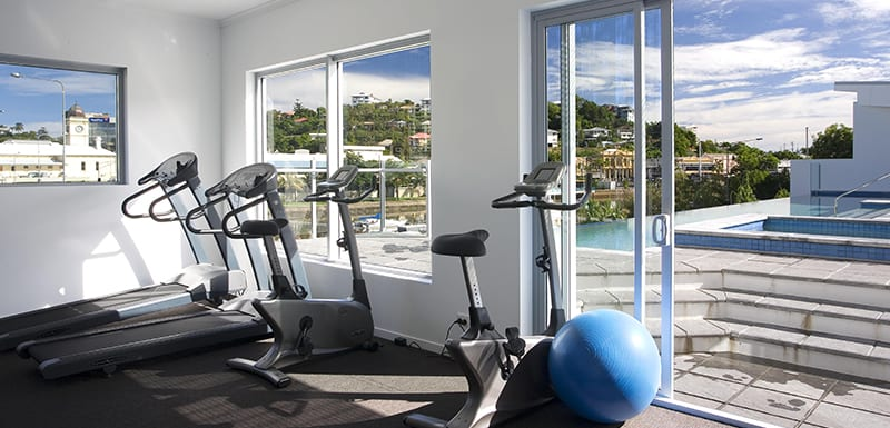 fully equipped gym with air con, weights, treadmill and cycle machine at Gateway on Palmer hotel in Townsville, QLD