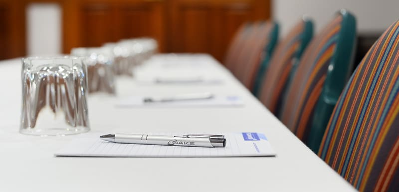 pen laying on notepad on table in conference room for hire near airport in Gladstone, Queensland, Australia