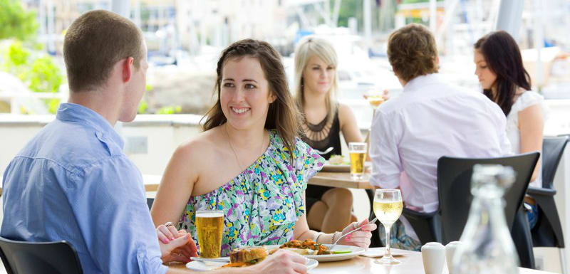 young couple enjoying delicious steak lunch at popular Metropole Restaurant in Townsville