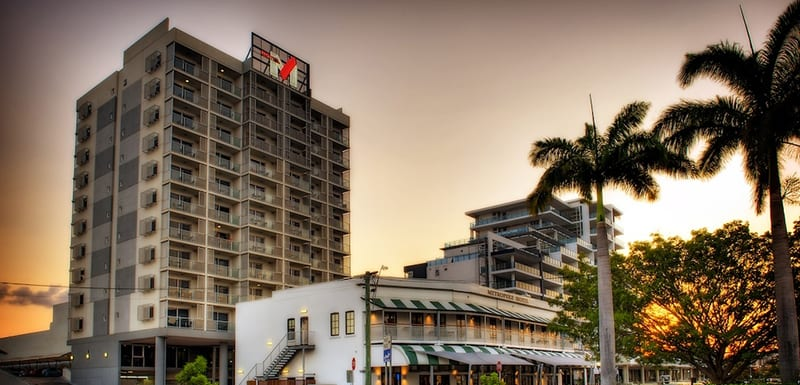 exterior view of Oaks Townsville Metropole Hotel on Palmer St in Townsville at sunset with Metropole Restaurant next door