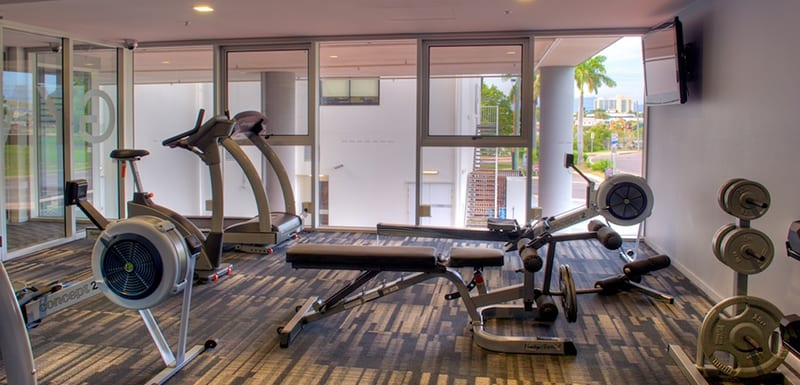 Fully equipped gym with rowing machine, treadmill and weights at Oaks Townsville Metropole Hotel in Townsville