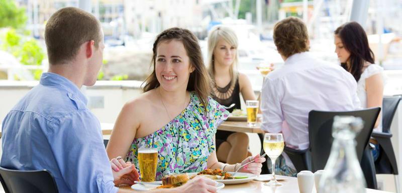 couple on romantic trip enjoying breakfast at Metropole Hotel restaurant in Townsville