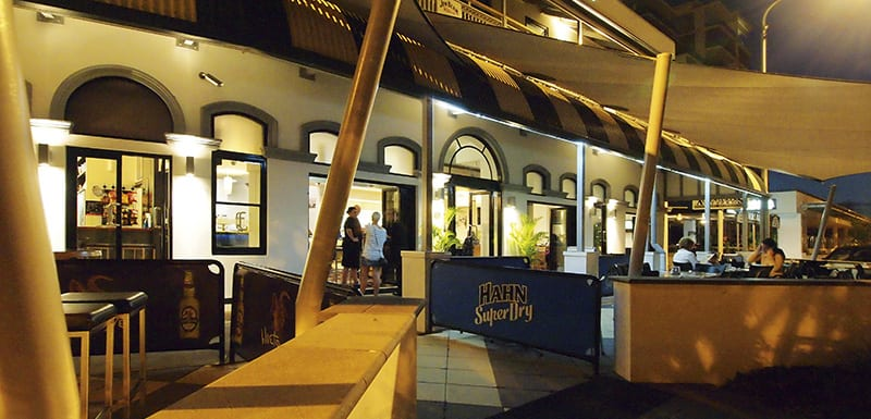 customers eating good food on tables outside Metropole Hotel restaurant in South Townsville, Queensland, Australia