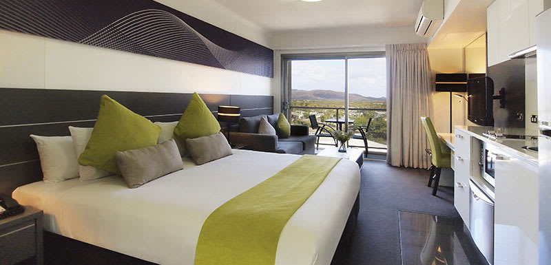 Best Townsville hotels air conditioned bedroom with Wi-Fi, TV and private balcony in hotel apartment
