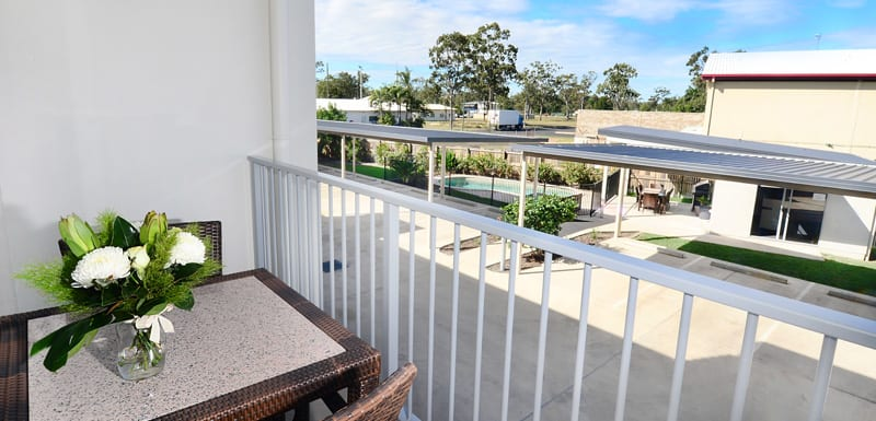 private balcony of 2 bedroom apartment with table and chairs and views of Middlemount near airport and golf club