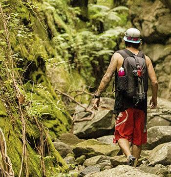 Man walking through forest in Middlemount, Queensland, Australia