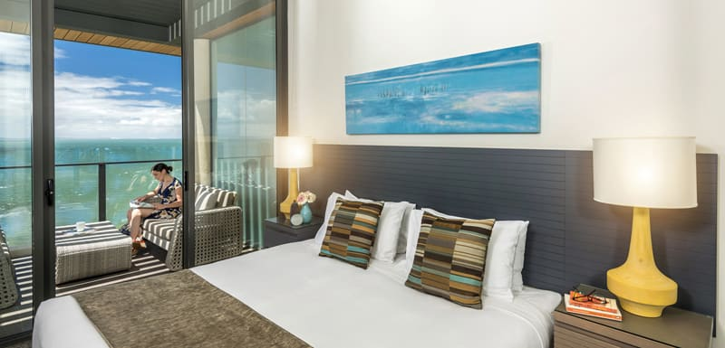 air conditioned master bedroom in Redcliffe hotel with private balcony at Oaks Mon Komo Hotel