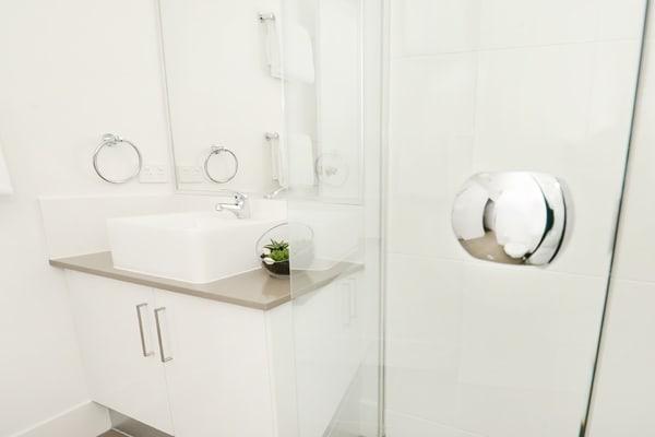 en suite bathroom of 1 bedroom apartment with shower and toilet at Oaks Moranbah hotel