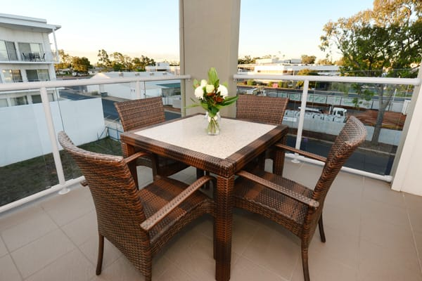 private balcony with table and chairs in 2 bedroom apartment at Oaks Moranbah hotel