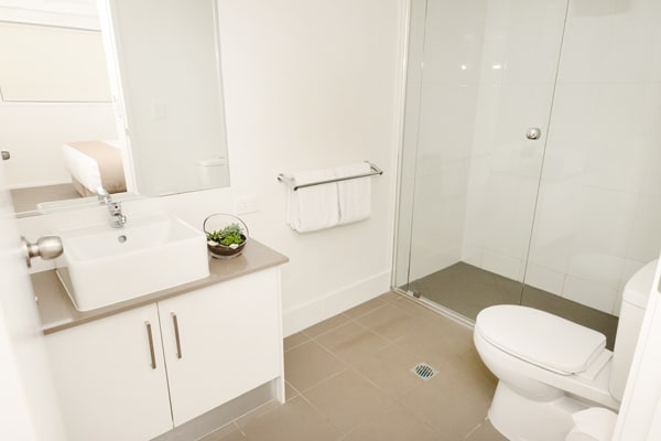 en suite bathroom with large disabled access shower and toilet at Oaks Moranbah hotel