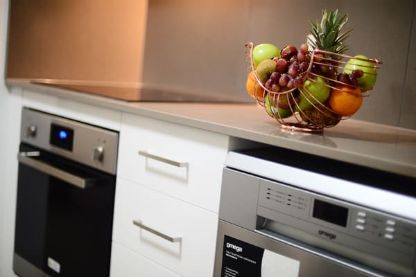 kitchen with oven, fridge and microwave in 2 bedroom apartment hotel accommodation near Moranbah airport