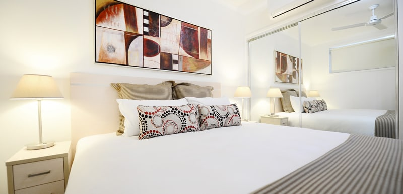 Oaks Moranbah hotel master bedroom in two bedroom apartment with air conditioning and ceiling fan
