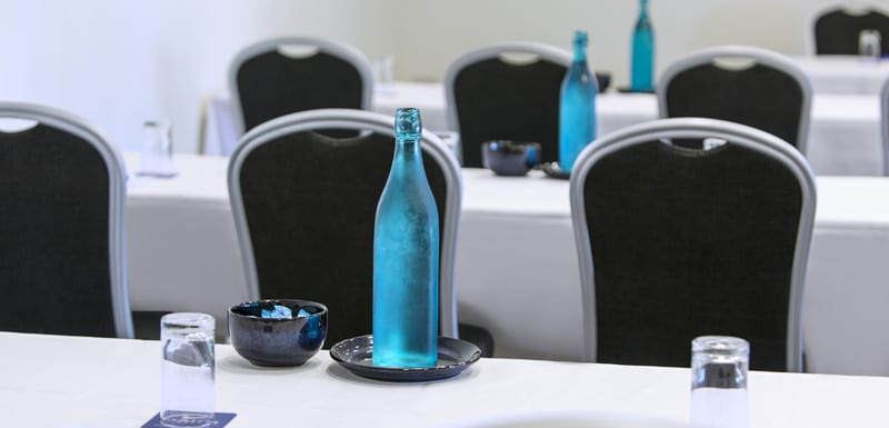zoomed in view of table setting ready for conference in function room for hire on Sunshine Coast
