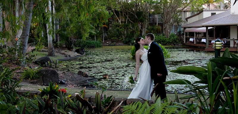 oaks oasis resort sunshine coast bride and groom by lake at sunset photoshoot after wedding