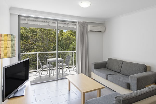 Oaks holiday Resort Port Douglas lounge room with tv and air conditioning
