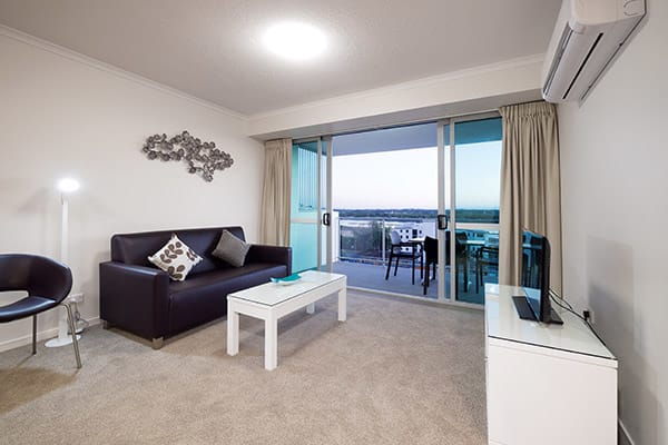 large air conditioned living room in two bedroom apartment for corporate travellers visiting Mackay on business