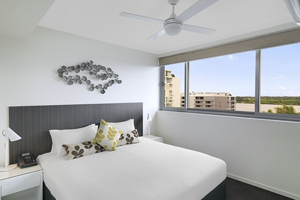 sunlight coming through large windows of two bedroom apartment with views of Mackay in Queensland