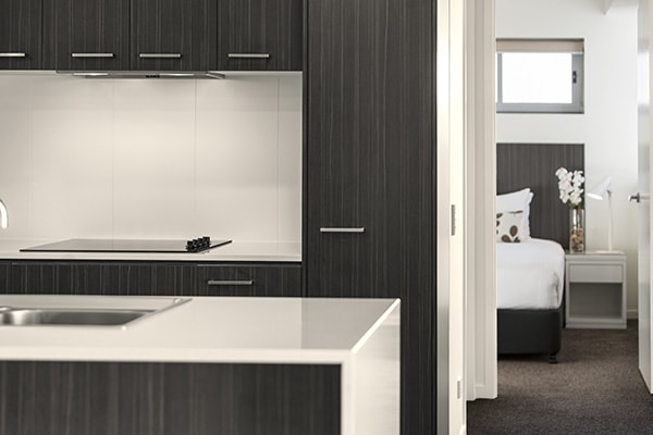kitchen with toaster, microwave and kettle in air conditioned two bedroom apartment at Oaks Rivermarque hotel in Mackay, Queensland, Australia