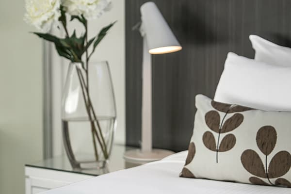 pillows on clean sheets of bed in Studio room apartment at Oaks Rivermarque hotel in Mackay, Queensland, Australia