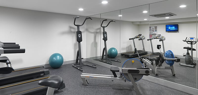 fully equipped gymnasium with air conditioning, treadmill, weights and rowing machine at Oaks Rivermarque hotel in Mackay, Queensland, Australia