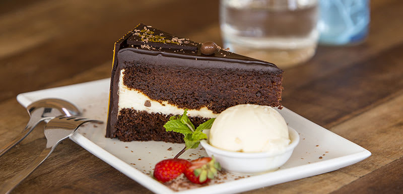 delicious chocolate cake desert with ice-cream at popular Marque cafe and restaurant in Mackay, Queensland, Australia