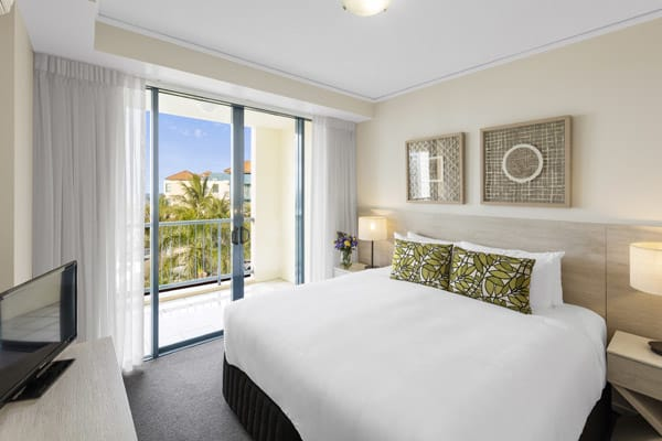 TV with Foxtel in master bedroom of 2 bedroom apartmnet with private balcony overlooking ocean at Oaks Seaforth Resort hotel, Sunshine Coast