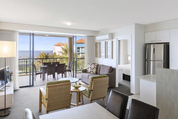 air conditioned 2 bedroom penthouse apartment living room with TV and private balcony at Oaks Seaforth Resort hotel, Alexandra Headlands, Sunshine Coast