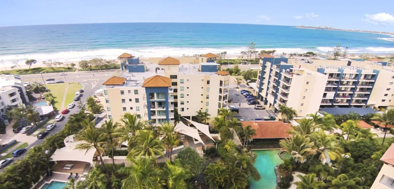 aerial view of Oaks Seaforth Resort hotel with Mooloolaba beach and ocean in background on Sunshine Coast, Queensland, Australia