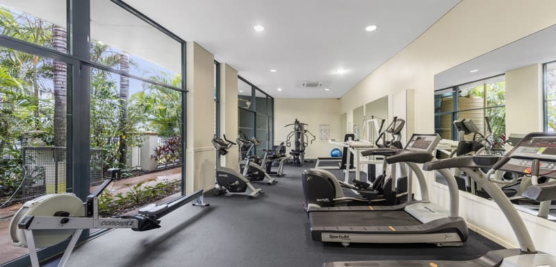 fully equipped gym with air conditioning, treadmill, rowing machine and weights room at Oaks Seaforth Resort hotel, Sunshine Coast, Queensland, Australia