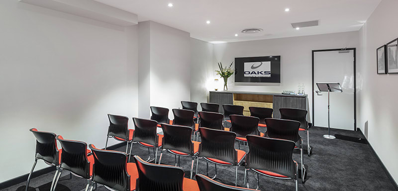4 rows of comfortable chairs in meeting room for hire in Adelaide city with air conditioning and Wi-Fi access
