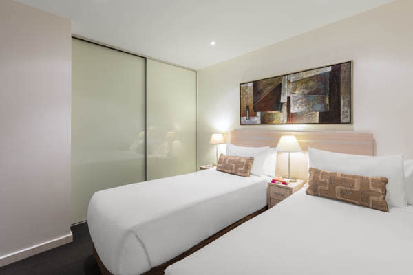 two single beds in second bedroom of 2 bed apartment with free Wi-Fi and air con at iStay Precinct hotel in Adelaide city