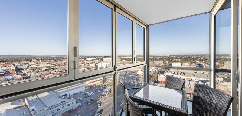 balcony with big windows and great views of Adelaide Oval from balcony of 2 bedroom apartment at iStay Precinct hotel