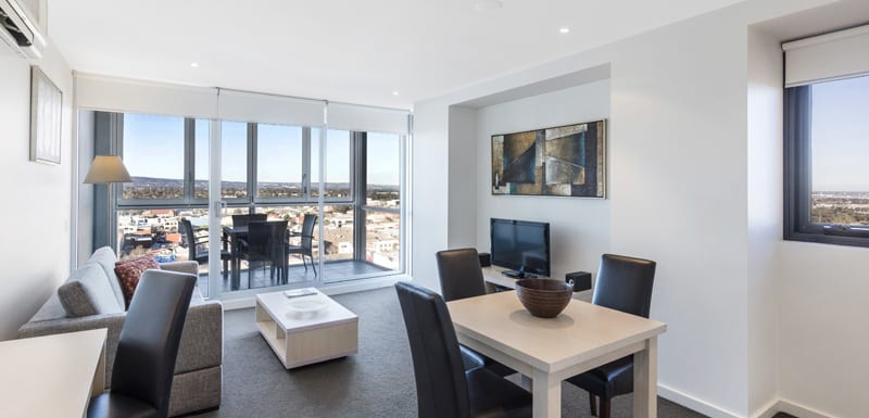 air conditioned living room in 1 bedroom apartment with free Wi-Fi at iStay Precinct hotel near Adelaide Oval cricket ground
