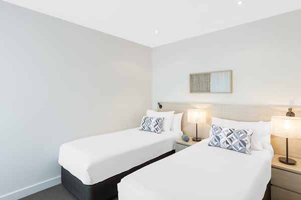two single beds in second room of family friendly 3 bedroom apartment with free Wi-Fi just a short walk to Glenelg beach in South Australia