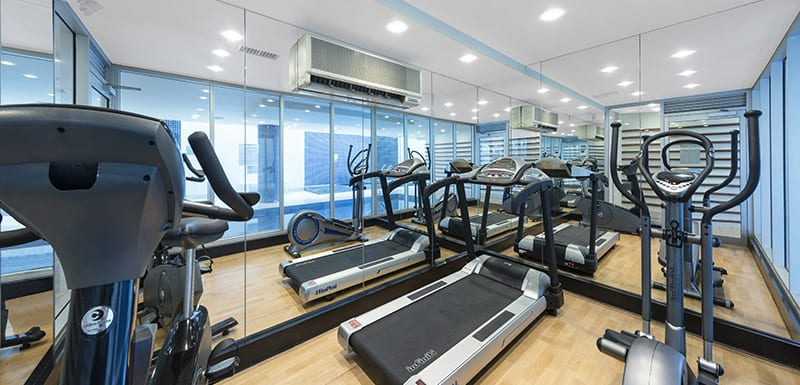 fully equipped gym with weights, treadmill, rowing machine and air conditioning for guests staying at Oaks Liberty Towers hotel in Glenelg, South Australia